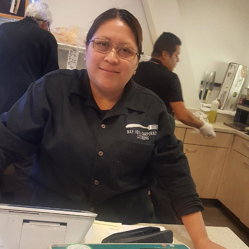 Lisette of Bay Area Corporate Catering assists in a company cafe